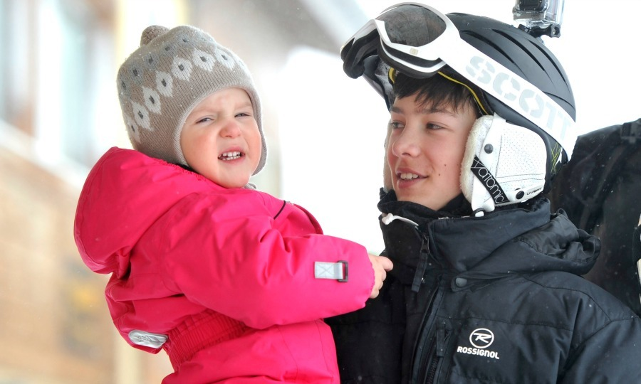 Nikolai shared a sweet moment in the snow with his little sister Princess Athena in 2014. 