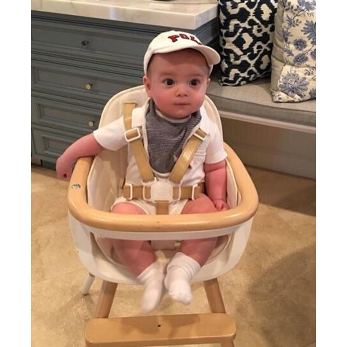 "Sitting <i>The-adorably</i>. Theodore sat perched up wearing a baseball cap to try out his highchair. Ivanka captioned the sweet photo, ""Theodore is taking his highchair for a test drive!""