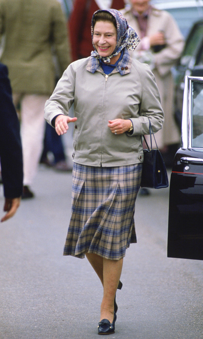 A young Queen Elizabeth II sported a tartan skirt, which coordinated perfectly with the pattern on her collar, when she arrived for a holiday in Scrabster, Scotland in 1986. 