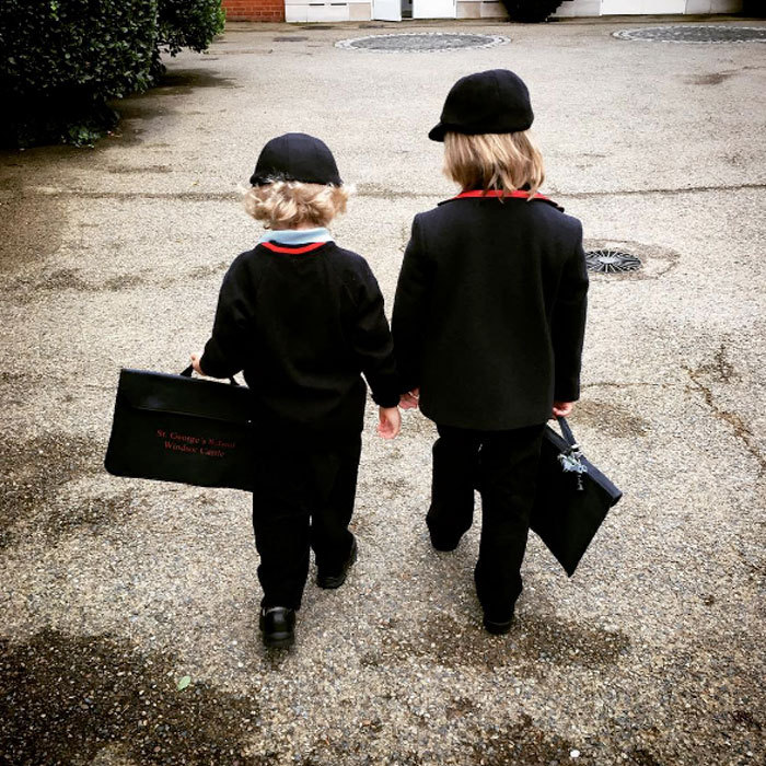 "Elton John's sons, Zachary and Elijah Furnish-John, were adorably twinning in matching trousers and red trimmed outerwear for their first day back to school. The singer simply captioned the photo of his boys in their uniforms: ""Back to school,"" adding the hashtag ""#ShareTheLove.""