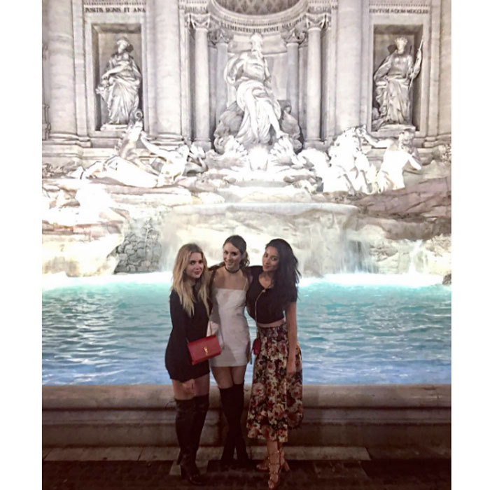"The girls have also taken in historic sites in Rome including the Trevi Fountain. Shay shared a photo with her fellow <i>Liars</i> in front of the fountain writing, ""Hanna, Spencer and Emily wishing for an AD free world at the Trevi Fountain / I almost jumped in and lived out my favorite scene in ""La Dolce Vita"" ...  #Bellisariogetsbooted.""