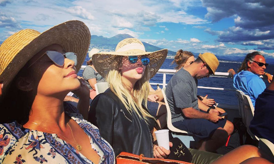 "Shay and Ashley donned their summer's best for a ferry ride in Europe. Troian shared a photo of the duo, which she captioned, ""Babes on a boat#bellisariogetsbooted.""