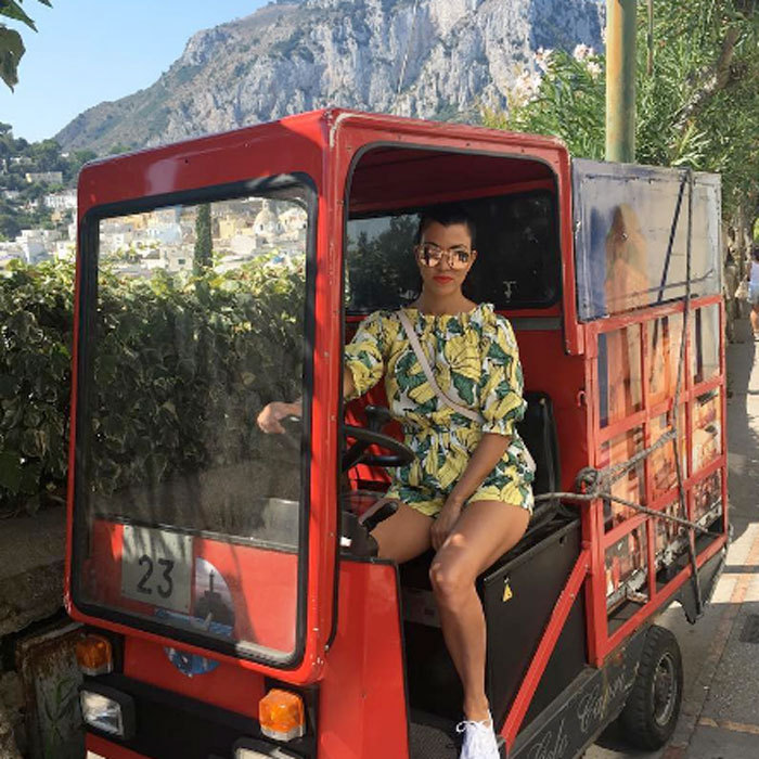 Special delivery! Kourtney Kardashian jumped behind the wheel of a red truck during her Italian vacation in Capri.