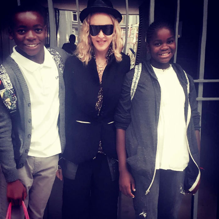 "Madonna is adjusting to the end of summer and first day of school. The Queen of Pop shared a photo with her youngest children, David Ritchie and Mercy James wearing their white polo uniform and trousers, writing, ""First Day of School!! I'm Good with 4 hours of sleep I swear!""