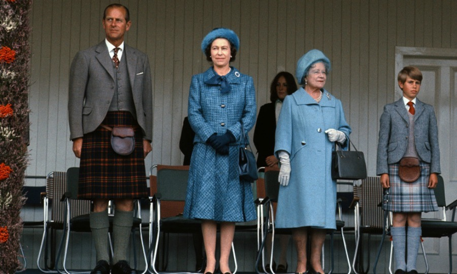 The Queen looked regal in blue as she stood with her mother Elizabeth, husband Prince Philip and youngest son Prince Edward at the Braemar Games in 1975. Edward sported a kilt made from Balmoral Tartan while his father Philip donned one in Scotland's more traditional red.