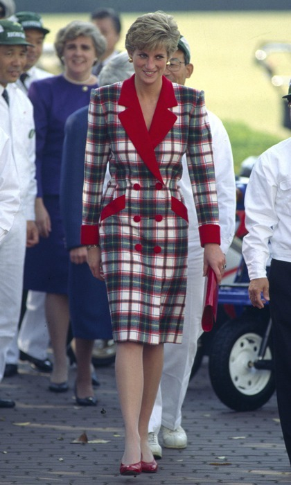 Diana made a statement during her 1990 tour of Japan in this tartan coat dress by Catherine Walker, highlighted with red accents. She later modernized the outfit when she cut the skirt's length to just above the knee. 
