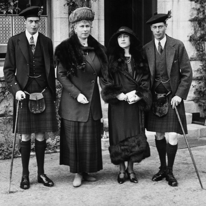 The future King George VI (far right) wore tartan during a visit to the family's Scottish retreat of Balmoral with his wife Elizabeth (right), mother Queen Mary (middle) and brother George, Duke of Kent, also in a tartan kilt (far left). 