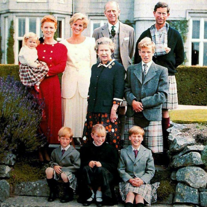 Prince Charles gave the Balmoral Tartan a new twist in 1990 when he used it to fashion a sling for his arm in this family portrait. The Prince of Wales became injured when he fell from his horse during a polo match in June. Prince Harry (left), Prince William (right) and Peter Phillips (middle right) are also seen here in kilts fashioned from the Balmoral Tartan.