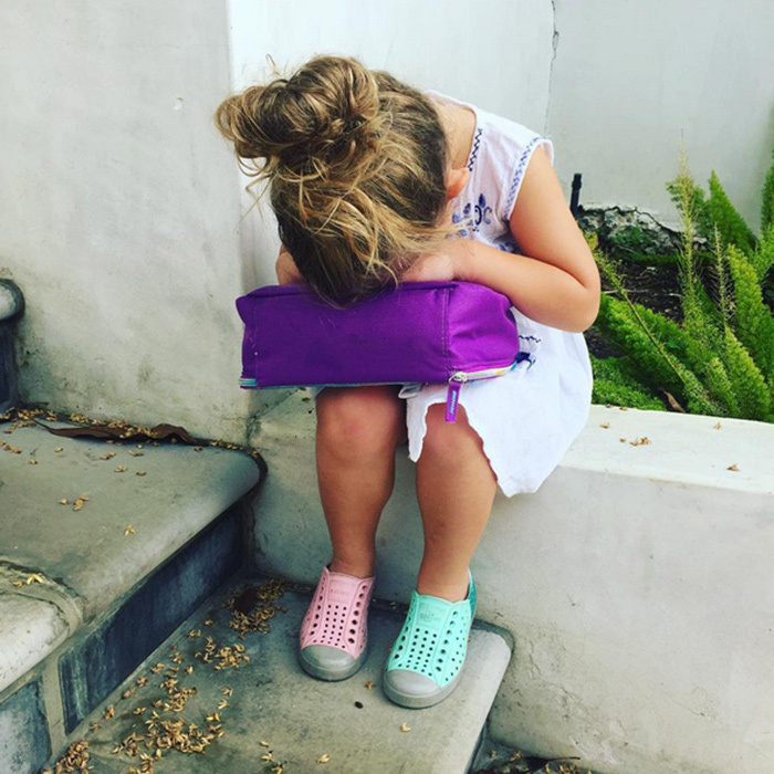 """Someone was NOT feeling the back to school vibe today,"" actress Busy Philipps captioned this pic of her daughter, who looked adorable in mismatched pastel shoes despite her lack of enthusiasm.