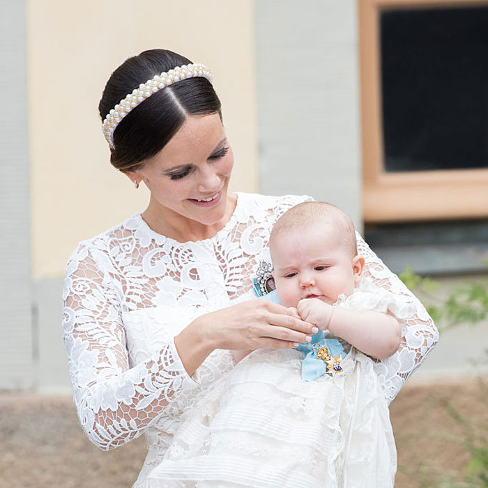 The Swedish Prince snuggled in his mother Princess Sofia's arms at his christening held at Drottningholm Palace Chapel.