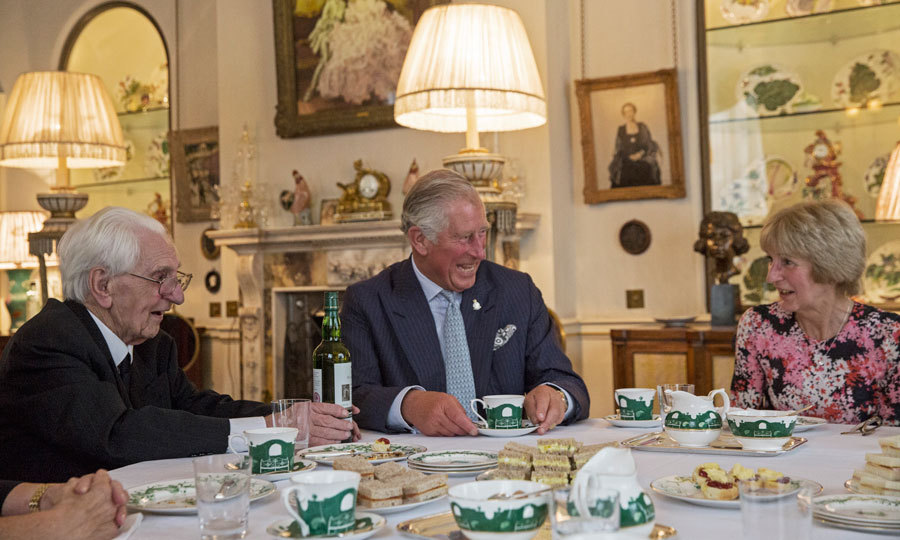 High tea and laughs! Prince Charles shared a joke with guests at a tea hosted at  Clarence House for veterans, widows and members of the Battle of Britain Fighter Association.