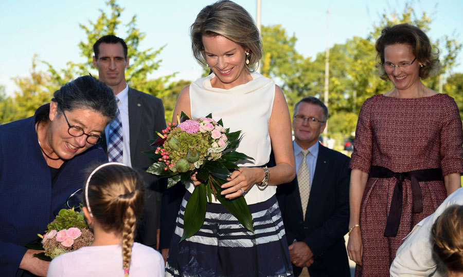 Queen Mathilde of Belgium (center) and Princess Sophie of Liechtenstein (right) were greeted with flowers during their visit to the thirteenth informal summit of German-speaking heads of states. 