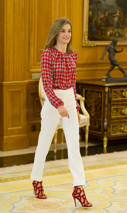 Queen Letizia of Spain looked radiant in a red printed blouse, which she paired with white trousers and red stylish heels, for audiences at Zarzuela Palace Palace.