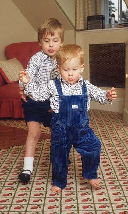 There's no buddy like a brother! Prince William lent his little brother a hand as Harry took his first steps at home in their playroom at Kensington Palace.