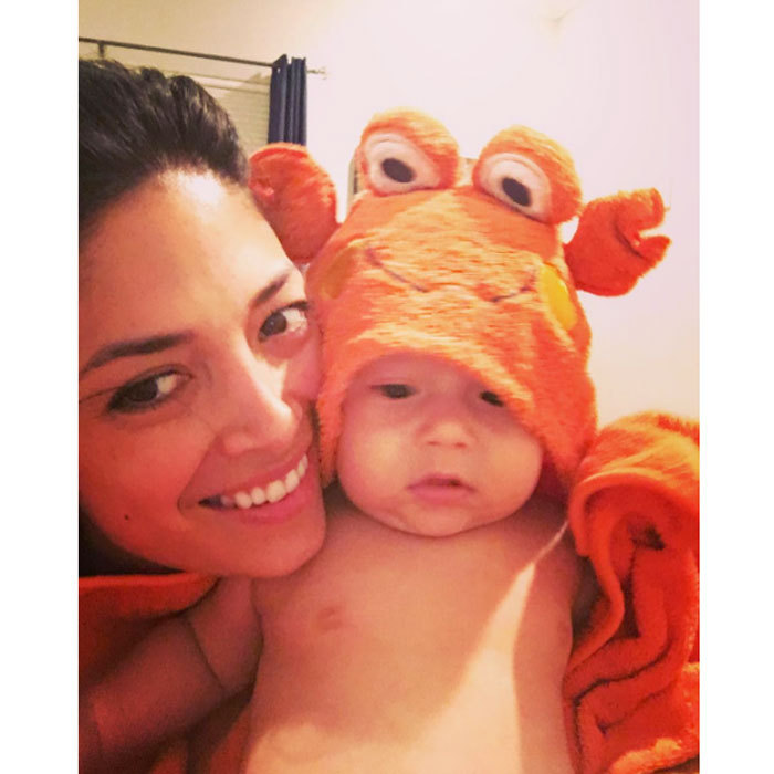 "Bathtime never looked cuter! Boomer Phelps modeled his crab bathrobe alongside his mom Nicole Johnson in an adorable picture that read: ""I guess I was being crabby...not sure why else I would have this thing on!!!""