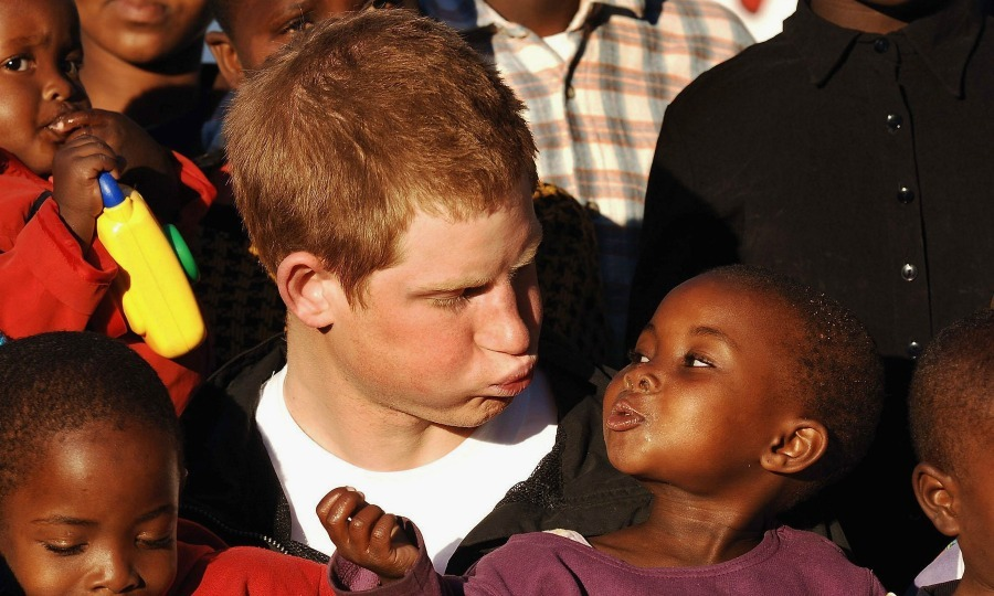 Face off! Harry made faces with one of the children at the Mants'ase children's home during a visit to Lesotho in 2006. 