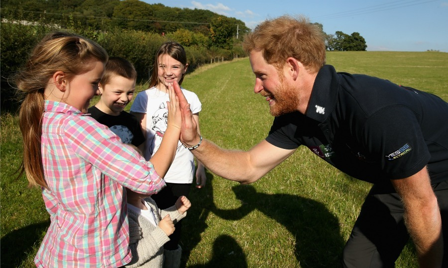 A lucky little girl got a high five from Harry while he took a break from the Walking with the Wounded's Walk in Ludlow, England in 2015.