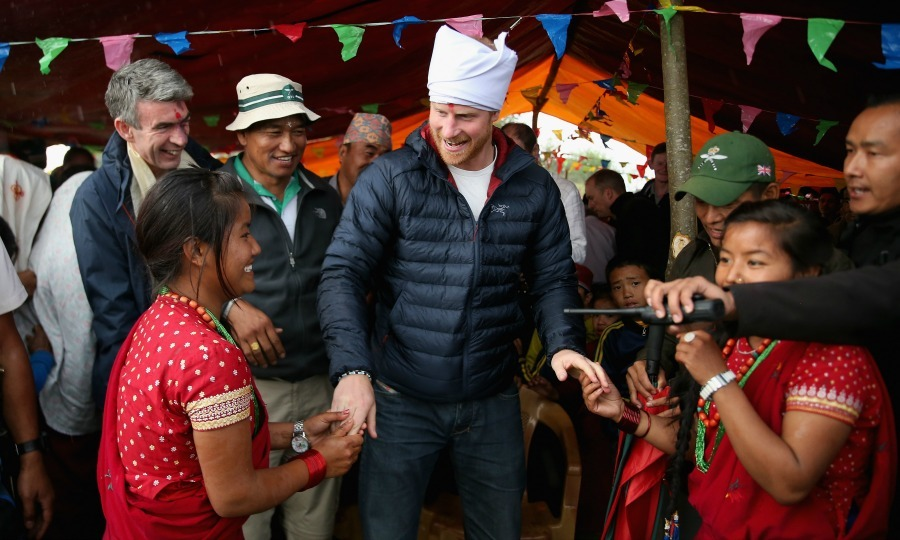 Prince Harry proved he is always up for a good time when dancing with two young girls in the rain during his visit to Nepal in 2016.