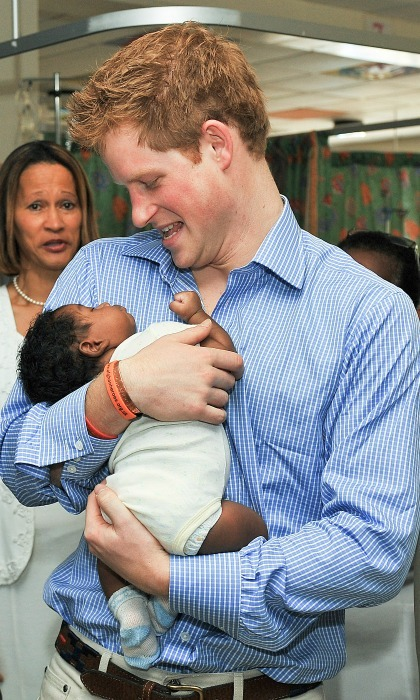 Harry couldn't resist the baby fever when he held Jean-Luc Jordan at the Queen Elizabeth ll hospital in Bridgetown, Barbados in 2010.