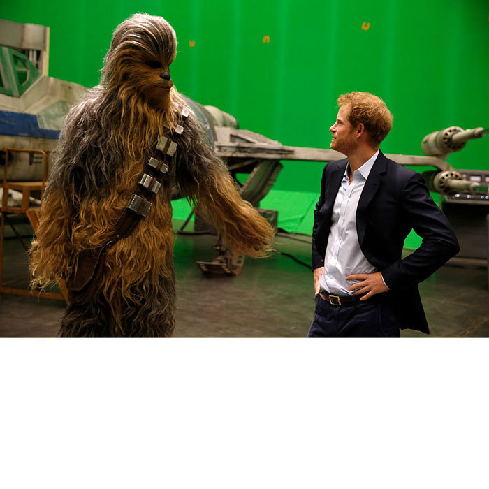 When Harry met Chewie! The royal met <i>Star Wars</i> character Chewbacca during a tour of the Star Wars sets at Pinewood studios in 2016.