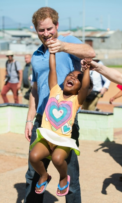 Prince Harry had some fun with four-year-old Sinentlantla Jacobs in Cape Town, South Africa in 2015. 