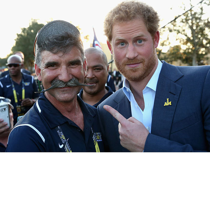Harry posed for a fan(tasche)tic photo with a USA Invictus Team member's moustache prior to the 2016 Invictus Games opening ceremony in Orlando, Florida.