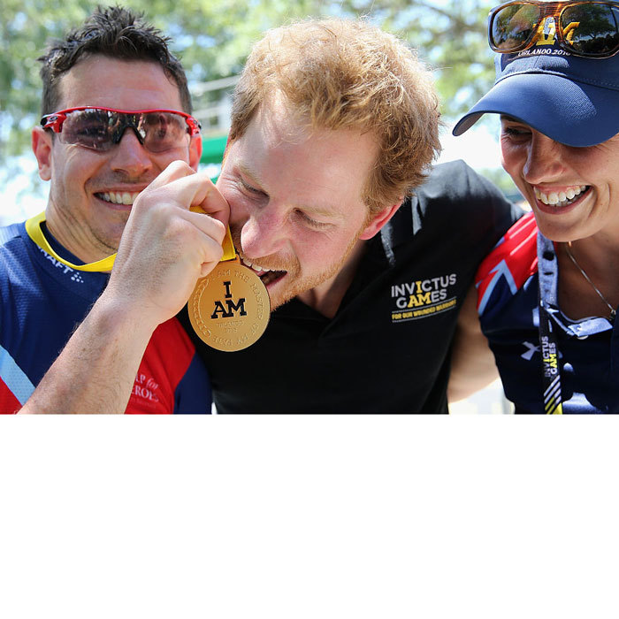 Going for the gold, literally! Harry bit Jaco van Gass's goal medal at the road cycling event during the 2016 Invictus Games.
