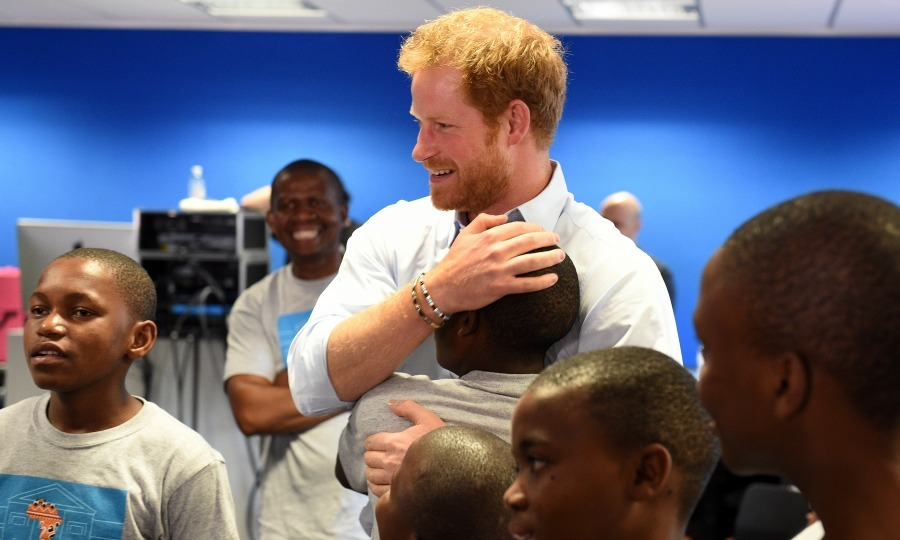 Harry and 16-year-old Relebohile 'Mutsu' Potsane embraced ahead of the children's performance at the Sentebale Concert at Kensington Palace. The young boy and the Prince first met in 2004 during Harry's first visit to Lesotho. 