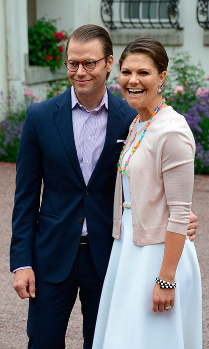Even though it was his wife's special day, Daniel was all smiles as he posed with Victoria during her 37th birthday celebrations at Solliden in July 2014. 