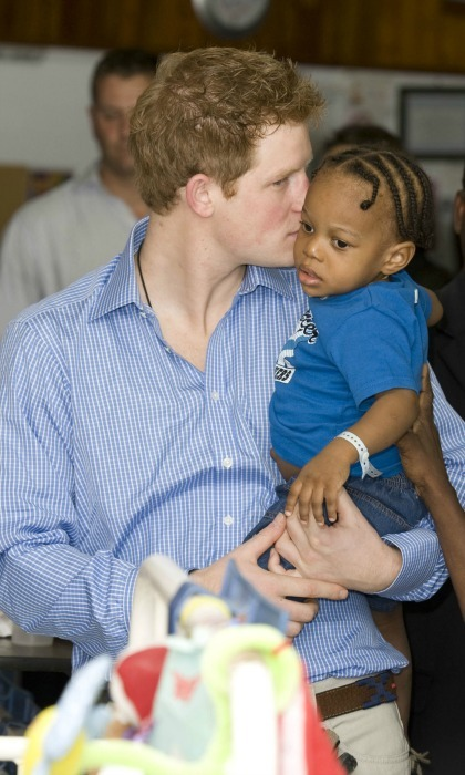 Harry snuggled close to Tyrell Richards, a young patient at the Queen Elizabeth ll in Bridgetown, Barbados in January 2010. 