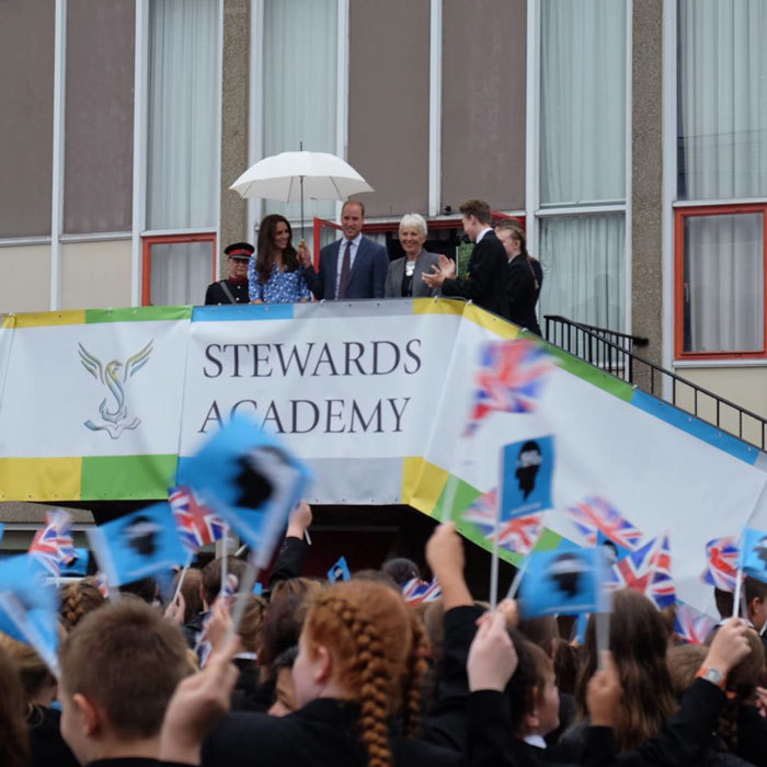 The royals received a warm welcome, complete with waving flags, from the students and staff of Stewards Academy.