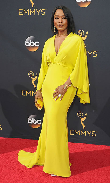 "Angela Bassett shined in a Christian Siriano gown at the award show. Emmy winner Courtney B. Vance tweeted a photo of his wife's bright look writing, ""Who's hotter at the@Emmys tonite? The sun, or my wife @ImAngelaBassett?""