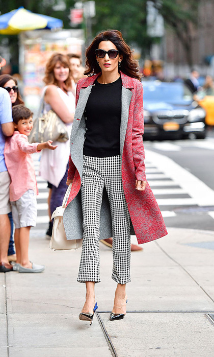 While in New York City to address the United Nations regarding ISIS' genocide, Amal took to the streets wearing a lace red Altuzarra coat and checkered pants paired with Giambattista Valli pumps.