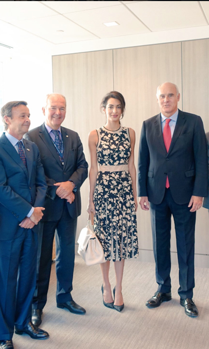 Amal made a floral statement donning a silk Michael Kors dress that featured a pleated hemline to meet with the Ambassador of the European Union to the United Nations, Joao Vale de Almeida (right).