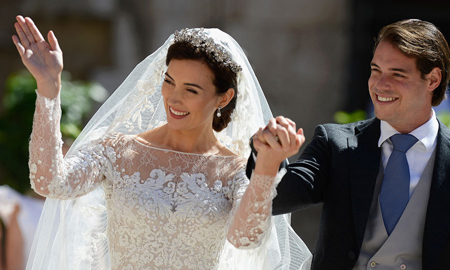 Prince Felix's wife chose a glittering floral tiara to sit atop her glossy brunette locks on her special day. She accessorized with a pair of dazzling diamond earrings, believed to be the same ones worn by Princess Stephanie of Luxembourg and Grand Duchess Maria Teresa on their wedding days, which complemented the stunning headpiece.