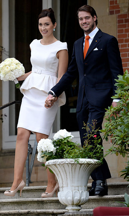For her special day, Claire, 28, the daughter of telecomms millionaire Hartmut Lademacher, wore a silk ivory dress with a peplum feature and knee-length hemline. She finished off her elegant outfit with aquamarine earrings. 