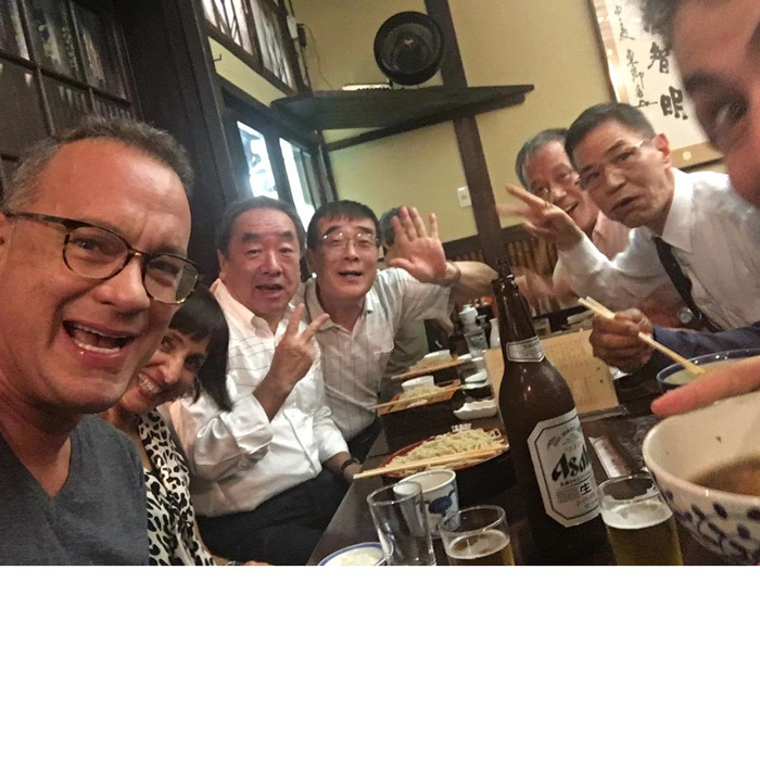 "Arigato from Japan! Tom Hanks shared a photo from his meal abroad, writing, ""Rocking Tokyo with my crew. Hanx.""