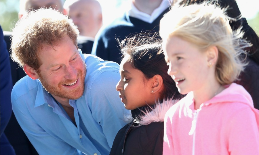 Harry took the time to chat with two girls during his extreme sports day. 