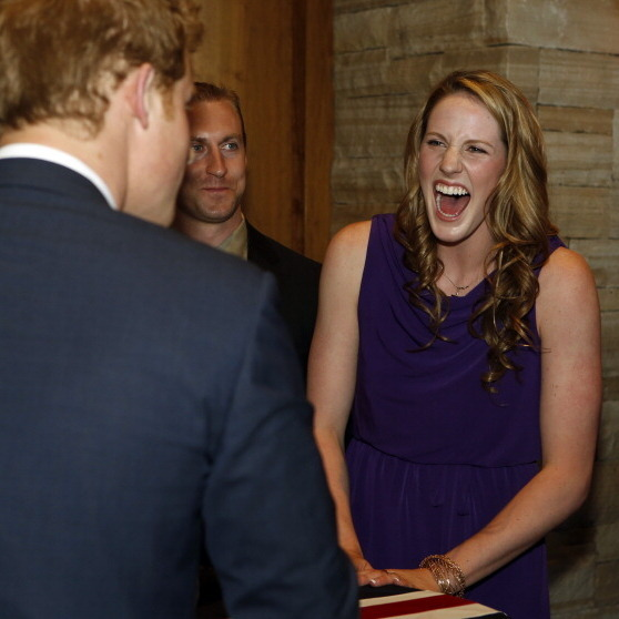 Olympic gold medalist Missy Franklin looked pleased to greet Prince Harry in 2013.