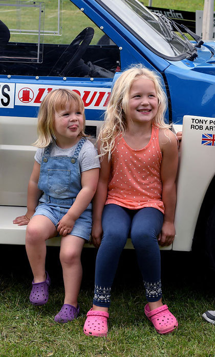 Zara Phillips' cheeky little girl stuck out her tongue, while twinning in Croc shoes alongside her big cousin Savannah Phillips.