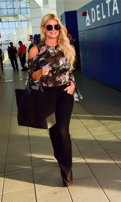 September 21: Jessica Simpson smiled for the camera as she strutted her stuff through the airport in NYC. 