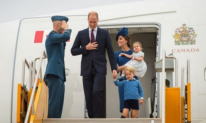 Prince George was led by Prince William as Kate Middleton held on to their little girl Princess Charlotte, who is on her first royal visit, upon arrival into Victoria International Airport.