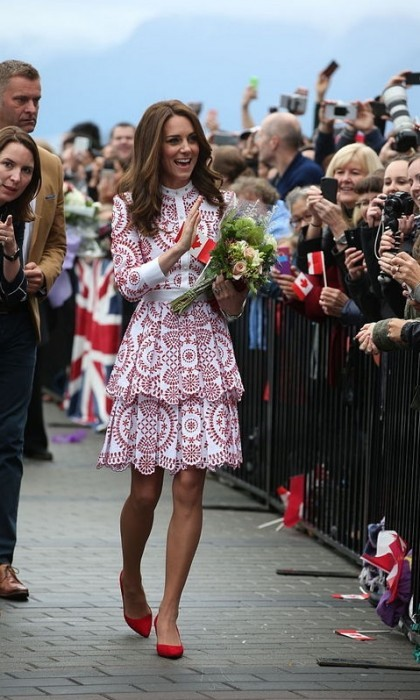 For her second day of her second royal tour to Canada, Kate  chose a red-patterned Alexander McQueen dress with red pumps as she and William visited Vancouver.