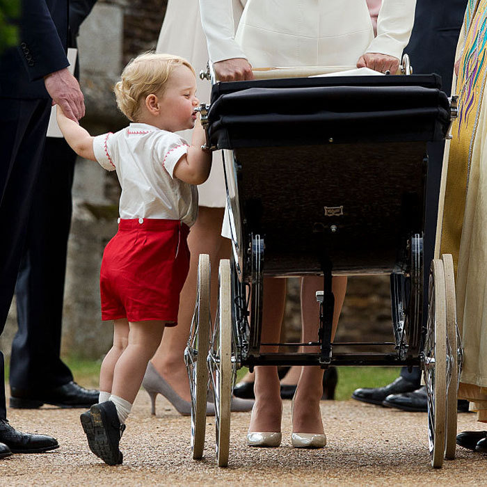 Big brother's looking out! George peered into his sister's pram at her July 2015 christening held at the St. Mary Magdalene's church.