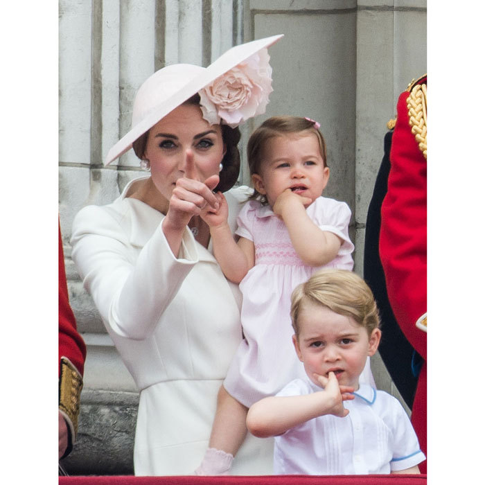 The royal brother and sister made the same gesture and face as their mother pointed out to the distance during the Trooping the Colour.