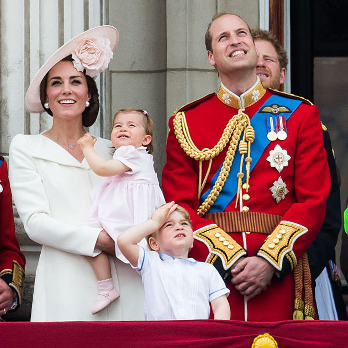 Charlotte and George both gazed up to watch the RAF fly over Buckingham Palace.
