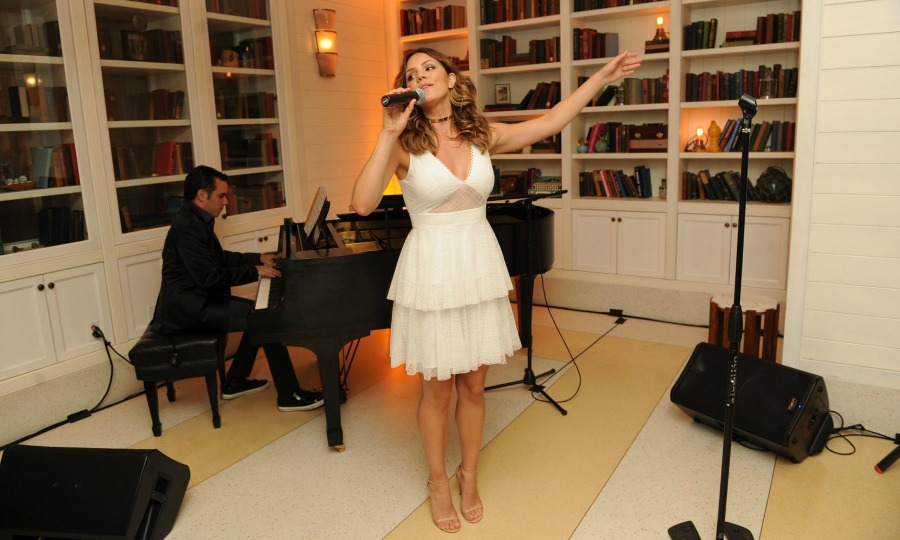 September 24: A song from the heart! Katharine McPhee took the stage during the celebration of her September cover of Ocean Drive magazine at the Confidante in Miami Beach. The songstress wore a white  Zac Posen dress with hair by Ricardo Rojas and makeup by Daniela Gozlan.