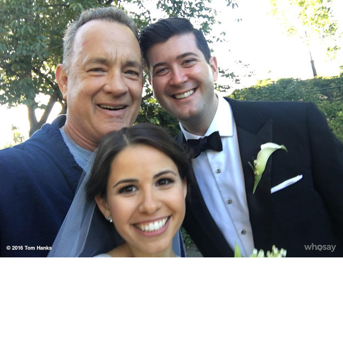 "Life is like a box of chocolates; you never know what you're gonna get...like Tom Hanks crashing your wedding photos! One newlywed couple in New York City unexpectedly had their photo session in Central Park crashed by the Oscar winner. Tom snapped a selfie with the lovebirds, which he shared on Twitter writing, ""Elizabeth and Ryan!  Congrats and blessings!  Hanx.""