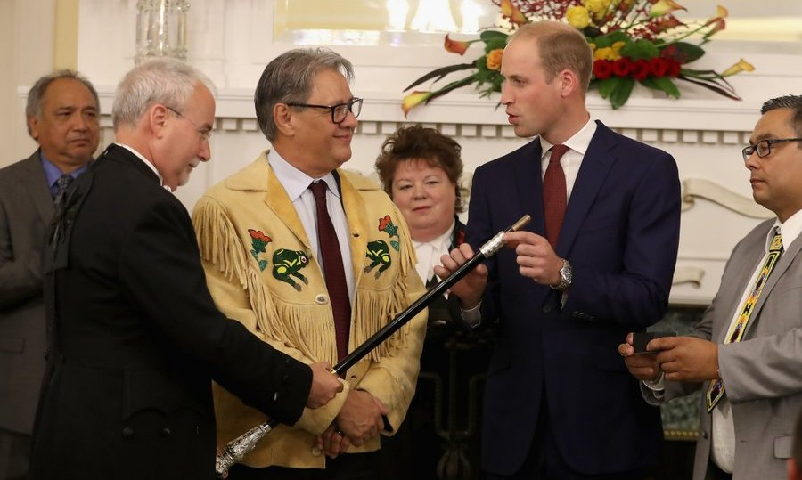 William had the honor of adding a 'ring of reconcilation' to the Black Rod, a ceremonial staff of British Columbia's Legislature modeled on the one used in British Parliament. Grand Chief Edward John of the Tl'atz'en, wearing a fringed jacket, helped hold the Black Rod as Chief Shane Gottfriedson handed William a ring, engraved with eagle feathers and a canoe to symbolize First Nations in the province, to place on it.