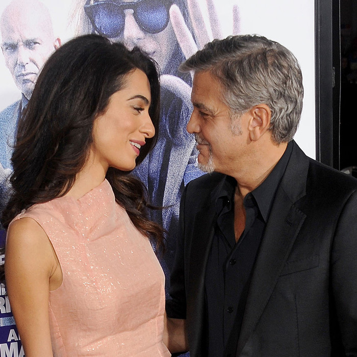 Amal and George couldn't keep their eyes off of each other at the 2015 Hollywood premiere of Warner Bros. Pictures' <i>Our Brand is Crisis</i>.